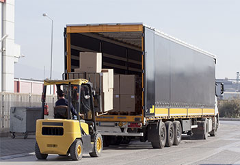 Semi trailer being loaded at a loading dock | Truckload Services